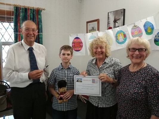 Exeter Yaroslavl Twinning Association members John and Joyce with young prize winner from «Общество Дружбы Ярославль - Эксетер» — with Galina Evstifeeva at InTC Russian Language School